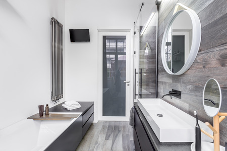 bathroom tiles: Small, bright bathroom in modern design with wooden style tiles