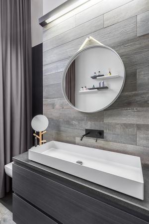 bathroom tiles: Bathroom with countertop washbasin and wood effect wall tiles