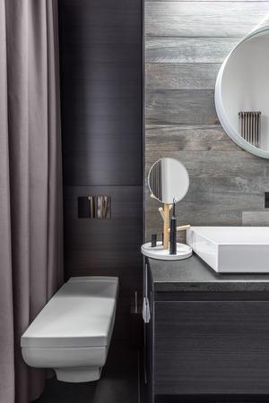 bathroom wall: Bathroom with wall mounted toilet and countertop basin Stock Photo