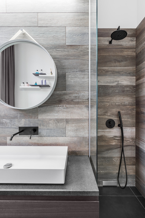 Modern bathroom with shower and wood effect tiling