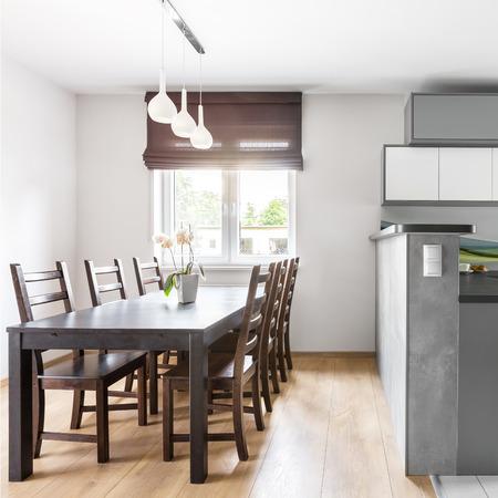 open floor plan: Modern villa interior with light spacious kitchen open to dining area with window Stock Photo