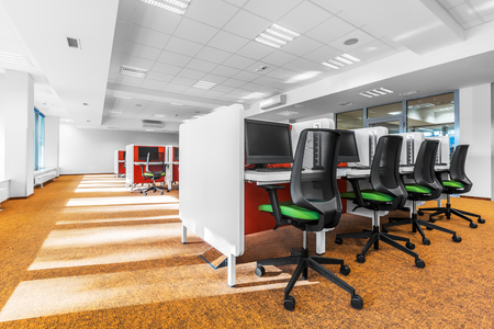 Stylish computer classroom with modern orange carpet on the floor