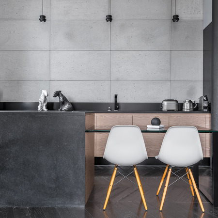 kitchen island: Modern kitchen with grey wall tiles, table and chairs