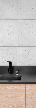 stone worktop: Vertical panorama of modern black tap and sink on black kitchen worktop