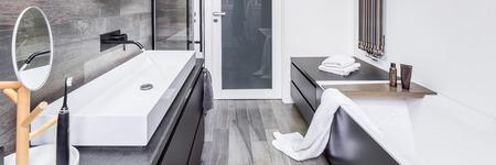 bathroom wall: Stylish bathroom with bathtub, countertop basin and wall heater, panorama Stock Photo