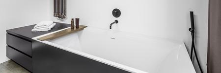 bathroom wall: Panorama of fancy bathroom interior with bathtub and wall heater