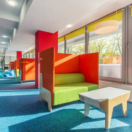 Library Lounge Area With Green Sofas And Red Partitions Stock Photo    73999559
