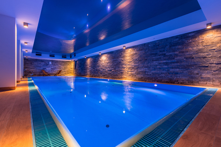 Luxury indoor swimming pool in modern hotel spa Banco de Imagens - 77776553