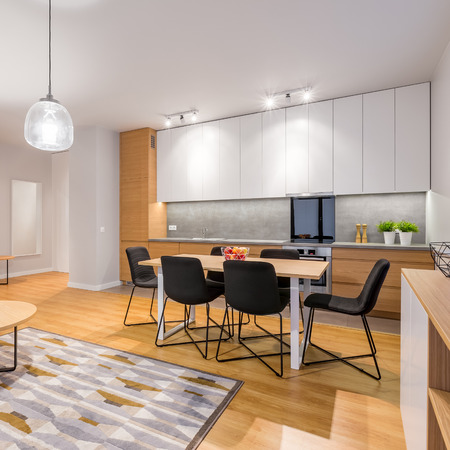 Interior Of Stylish, Modern Studio Apartment With Kitchenette And Dining  Area Stock Photo   78766216