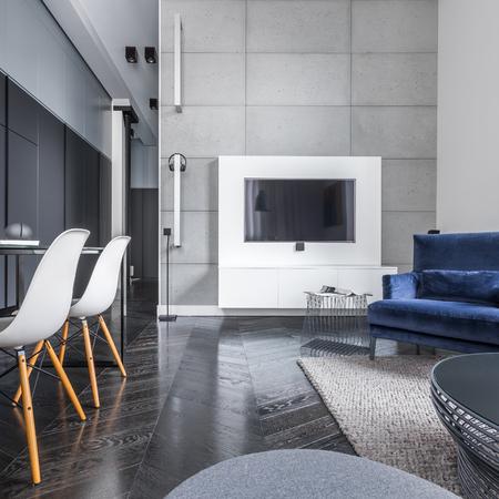 closet door: Studio flat with black wardrobe, table, tv and sofa Stock Photo