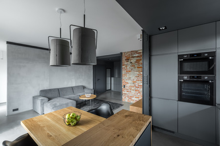 Modern loft with open living room, dining table and kitchen with island