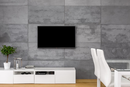 Tv living room with table, chairs and modern cabinet Foto de archivo