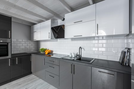Modern kitchen with white brick tiles and wooden ceiling