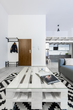 White living room with diy pallet table and pattern carpet