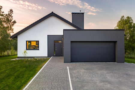 Modern house with garage and green lawn, exterior view Stock Photo - 81810618