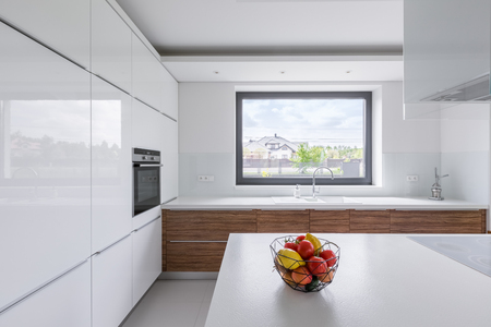 Modern design, white kitchen with island and big window Stok Fotoğraf