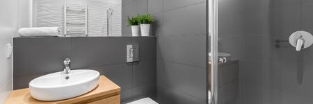 bathroom design: Modern grey bathroom with shower and round white basin panorama