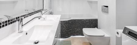 toilet: Elegant bathroom interior with modern black mosaic accents and big mirror, panorama