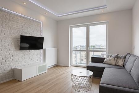 brick living room furniture. i living room with tv sofa balcony and white brick wall stock photo   88153850