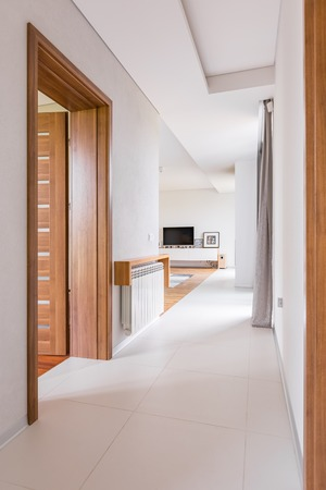 Modern Home Interior With Wooden Door White Walls And Floor Stock