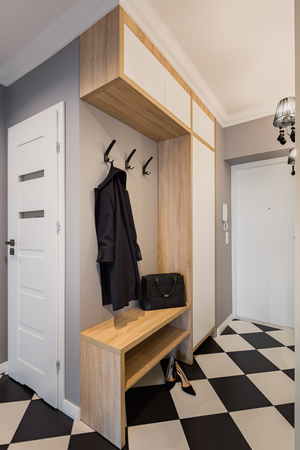 Modern mudroom with chess floor tiles and wardrobe