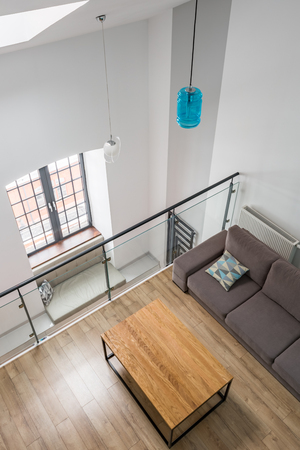 Top view of a mezzanine living room with table and couch Archivio Fotografico