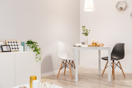 Dining area with two chairs and table in nordic style
