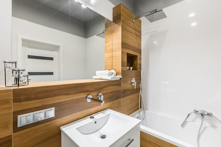 White and wood look ceramic tiles in contemporary bathroom