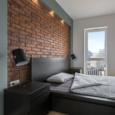 Industrial Style Bedroom With Red, Brick Wall And Double Bed Stock Photo    93440988