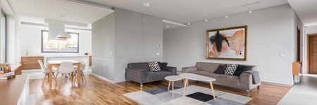 Modern apartment with open living room, kitchenette and dining area, panorama Foto de archivo