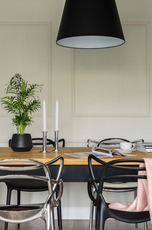 Wooden dining table with modern black and silver chairs