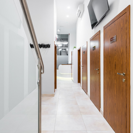 Frame of staircase and wooden doors in modern private clinic