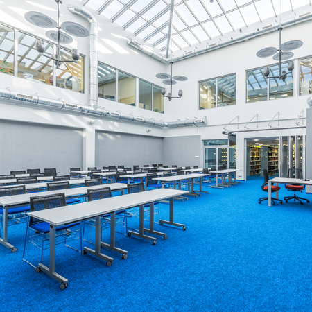 Modern and bright library meeting room in grey and blue Stock Photo