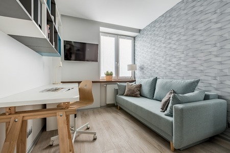 Office room with sofa and modern 3d wallpaper