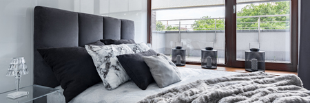 Luxurious bedroom with double bed, high gloss wall and big window, panorama Stock Photo