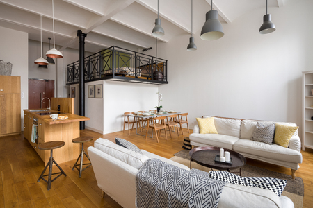 Stylish living room with wooden, open kitchen and mezzanine