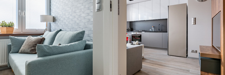 Panorama of new design apartment with contemporary sofa and kitchen 写真素材