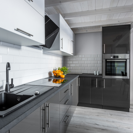 Beautiful black and white kitchen with simple cupboards