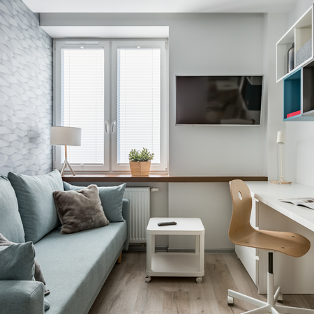 Cozy study room with desk, chair, couch and big window