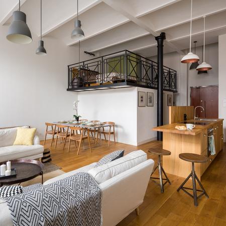 Open plan modern studio flat with cozy mezzanine bedroom