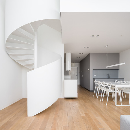 Home interior in new style with white, spiral staircase