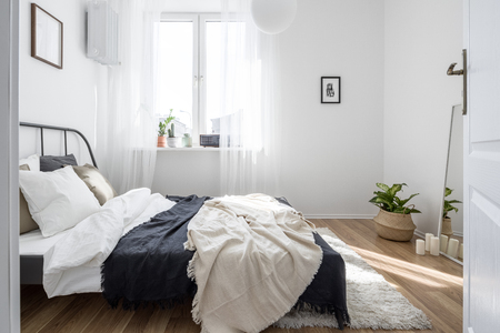Minimalist student bedroom in white with metal bed frame