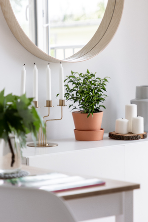 Cozy home interior in white with decorative and stylish accessories Banco de Imagens