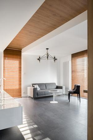 Minimalist and elegant home interior with decorative wooden details Banco de Imagens