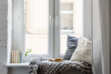 Home interior with cozy leisure area beside window