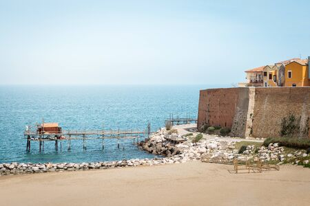 Traditional trabucco and part of fortification in Termoli city, Italy Reklamní fotografie