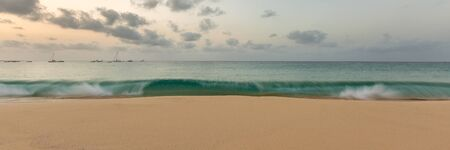Panorama of golden wide beach and big wave in Santa Maria, Sal, Cape Verde, Cabo Verde