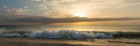 Panorama of golden sunset over atlantic ocean at beach in Santa Maria, Sal, Cape Verde, Cabo Verde