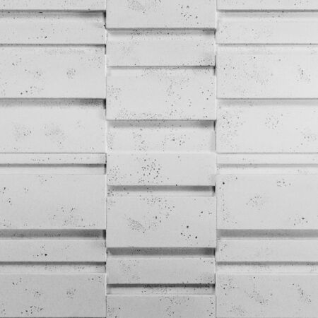 Close up on decorative, white stone wall tiles, architecture detail
