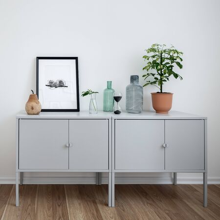 Contemporary interior with simple sideboard and decorative accessories